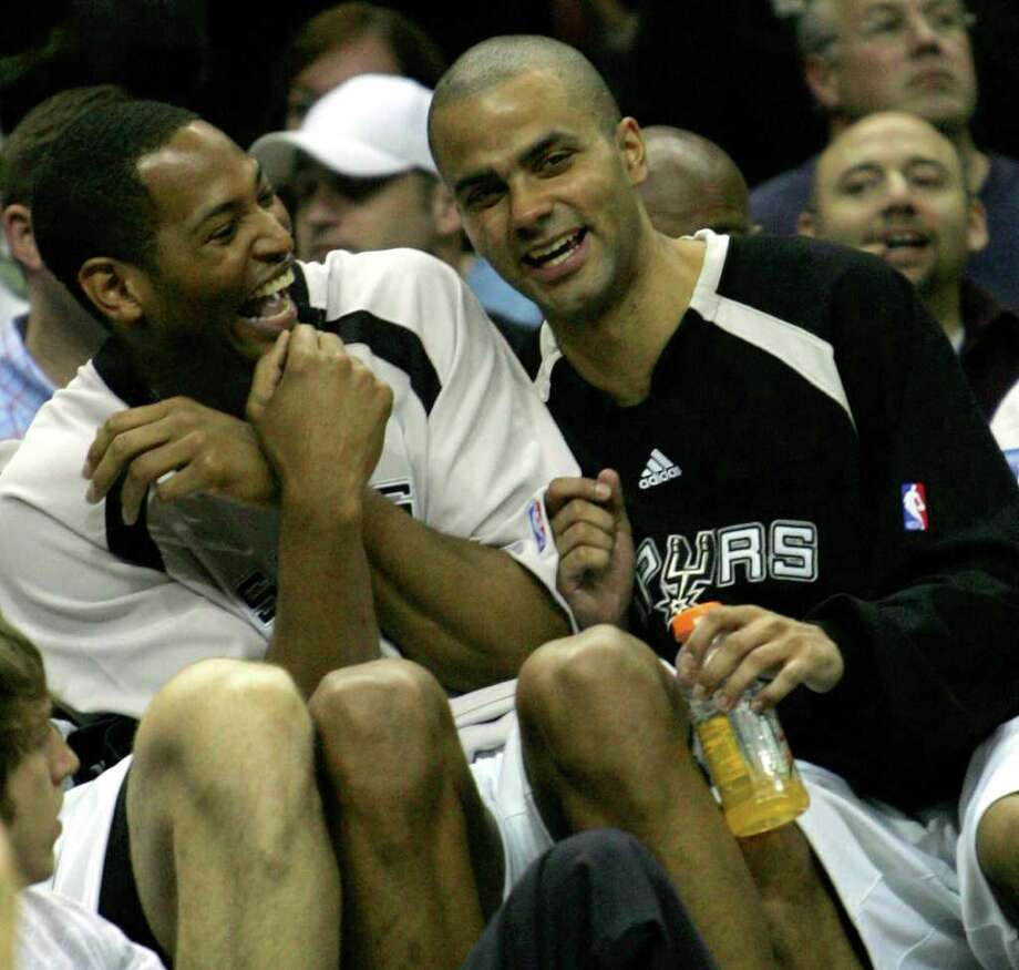 Spurs' forward Robert Horry (5), right and guard Tony Parker, of France, (09) enjoy their win over the Jazz  in the Western Conference Finals game five in San Antonio Wednesday May 30, 2007.  (JERRY LARA/STAFF) Photo: JERRY LARA, Express-News / SAN ANTONIO EXPRESS-NEWS