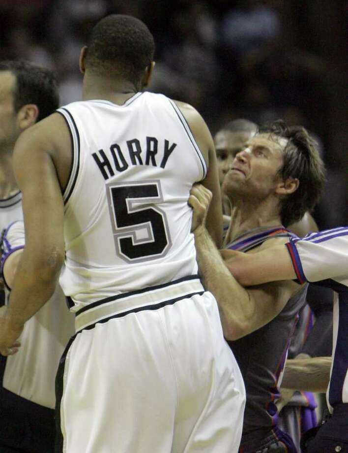 Phoenix Suns guard Steve Nash, right, of Canada, goes after San Antonio Spurs forward Robert Horry (5) in the fourth quarter of their second round playoff basketball game in San Antonio, Monday, May 14, 2007. Horry was ejected for the flagrant foul against Nash. The Suns won 104-98. (AP Photo/LM Otero) Photo: LM Otero, Express-News / AP