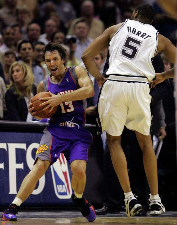 SPORTS - Suns' Steve Nash reacts to being fouled by Spurs' Robert Horry late in game four of their second round series Monday May 14 2007 at the AT&T Center. Horry was ejected. The Suns went on to win 104-98. BAHRAM MARK SOBHANI/STAFF Photo: BAHRAM MARK SOBHANI, Express-News / SAN ANTONIO EXPRESS NEWS