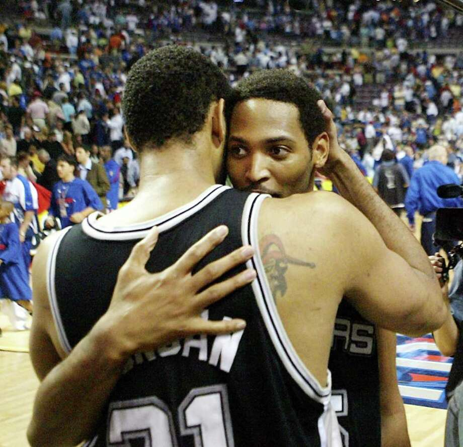 San Antonio Spurs' Tim Duncan (21) hugs teammate Robert Horry after the Spurs defeated the Detroit Pistons 96-95 in overtime of Game 5 of the NBA Finals in Auburn Hills, Mich., Sunday, June 19, 2005. Horry scored a three-pointer to win the game for the Spurs who lead the best of seven series 3-2. (AP Photo/Paul Sancya) Photo: PAUL SANCYA, Express-News / AP