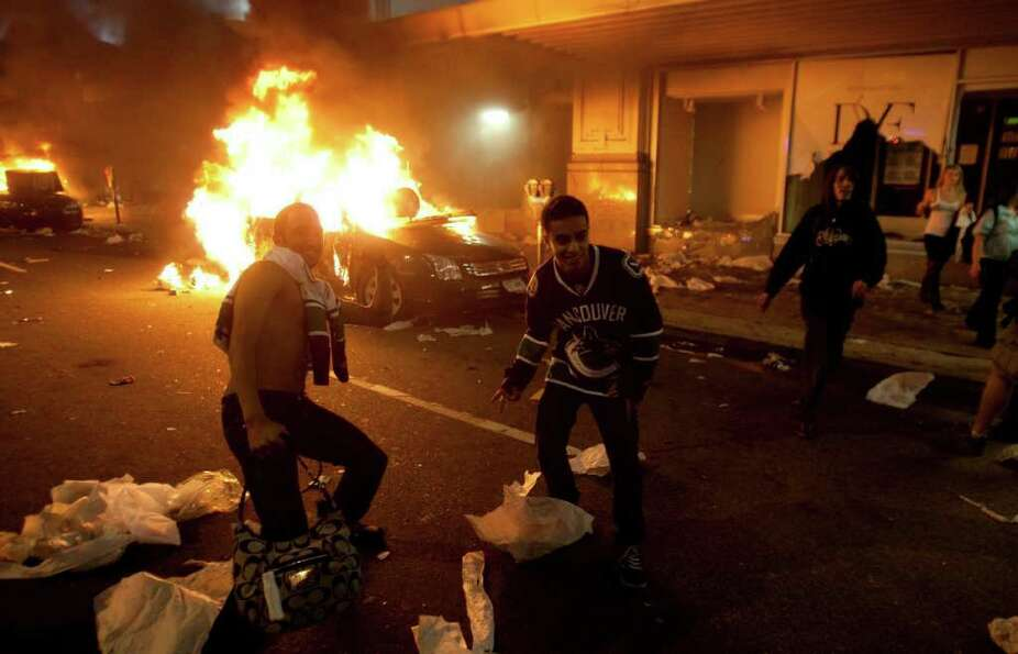 Vancouver Canucks hockey fans take part in a riot in downtown Vancouver, British Columbia Wednesday,