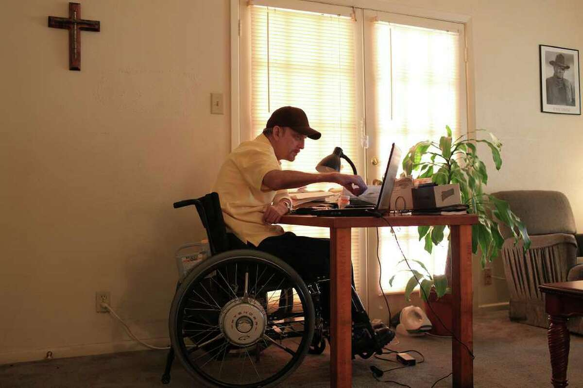 """""""You have to fight for everything when you are disabled. It's a constant battle being like this in the first place,"""" James Ford, a quadriplegic, says while working at his computer in the San Antonio apartment where he has lived for 21 years. Of the possibility of budget cuts that would affect his ability to live independently, Ford said, """"It's kind of tormenting, not knowing. ... It adds to the stress. It keeps you awake at night."""""""