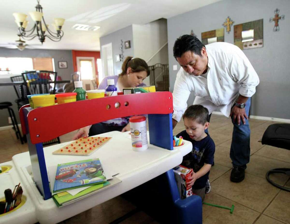 Robert Valadez and wife Sheena received early childhood intervention services from Brighton school for son Nicholas, 3. Because of budget cuts, he's being kicked out of the program.