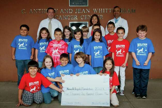 Wolfpit Elementary School students in Mr. Sullivan's class once again raise money for the Whittingham Cancer Center. They visited the center recently to present a check for $5,000. Photo: Contributed Photo / Norwalk Citizen
