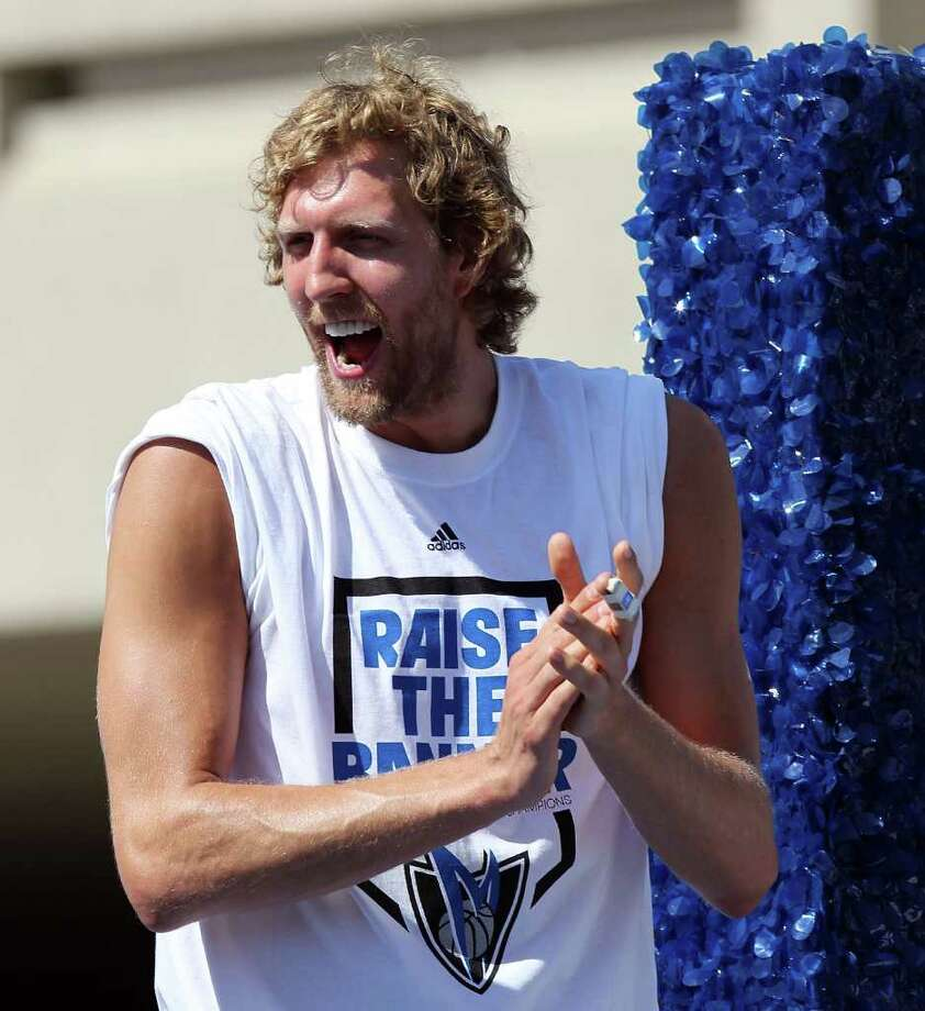 DALLAS, TX - JUNE 16:  Dirk Nowitzki of the Dallas Mavericks cheers during the Dallas Mavericks Victory Parade on June 16, 2011 in Dallas, Texas. Photo: Ronald Martinez, Getty Images / 2011 Getty Images