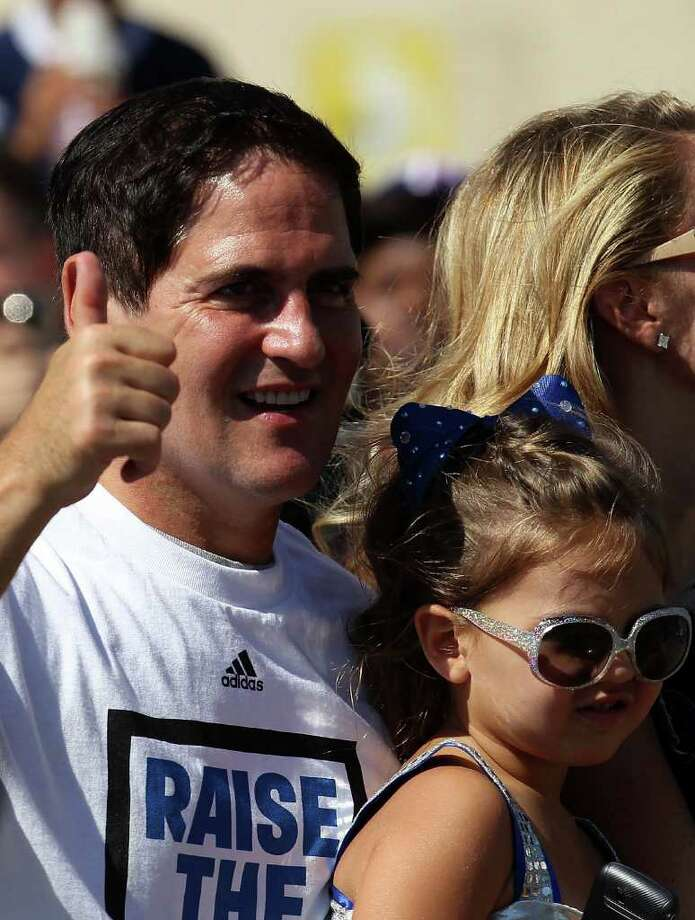 DALLAS, TX - JUNE 16:  Team owner Mark Cuban of the Dallas Mavericks cheers during the Dallas Mavericks Victory Parade on June 16, 2011 in Dallas, Texas. Photo: Ronald Martinez, Getty Images / 2011 Getty Images