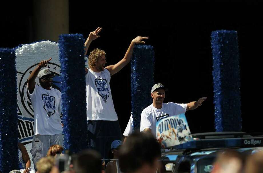 DALLAS, TX - JUNE 16:  (L-R) Jason Terry, Dirk Nowitzki and Jason Kidd celebrate during the Dallas Mavericks Victory Parade on June 16, 2011 in Dallas, Texas. Photo: Ronald Martinez, Getty Images / 2011 Getty Images