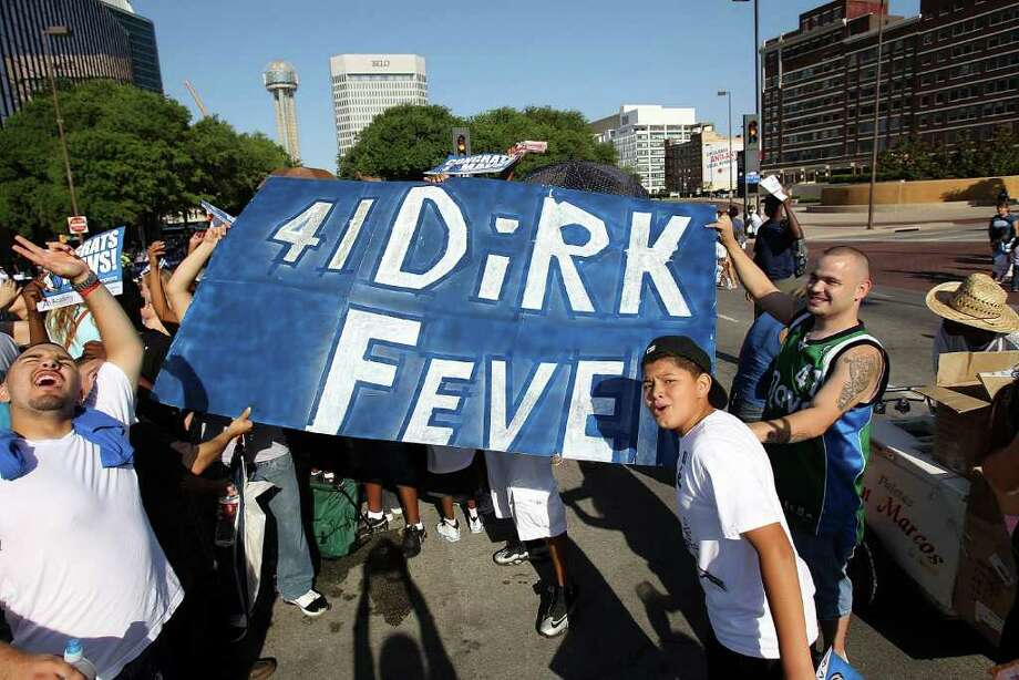 DALLAS, TX - JUNE 16:  Fans of the Dallas Mavericks hold up a sign for Dirk Nowitzki during the Dallas Mavericks Victory Parade on June 16, 2011 in Dallas, Texas. Photo: Ronald Martinez, Getty Images / 2011 Getty Images