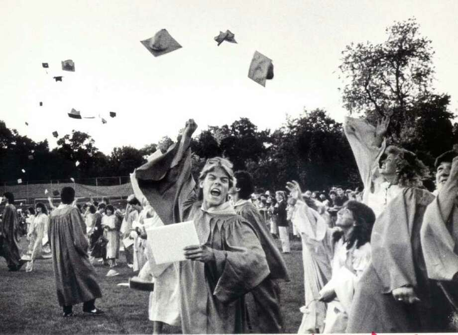 June 23, 1986: Celebration ensues as Westhill High School graduates the class of 1986. For a slideshow from Stamford and Westhill High School graduations from 1986, go to www.stamfordadvocate.com. Photo: File Photo / Stamford Advocate File Photo