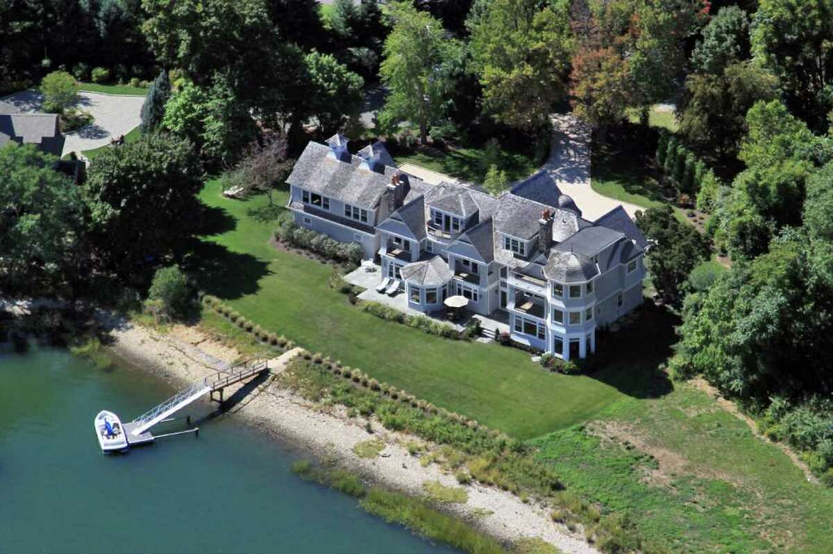 The 16-room, 9,682-square-foot colonial features 175 feet of shoreline frontage and its own private deep-water dock in a protected cove.