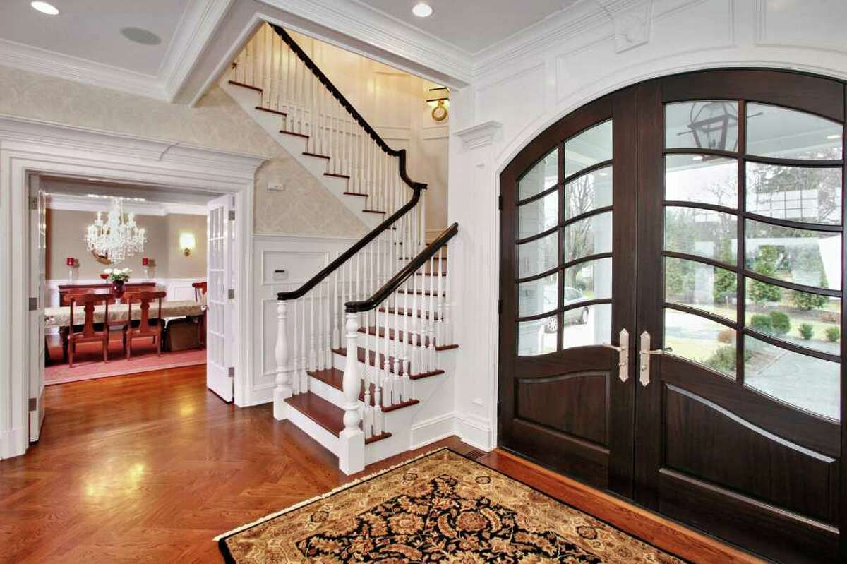 The house has a true center hall in a front-to-back grand foyer, which includes the formal front staircase.