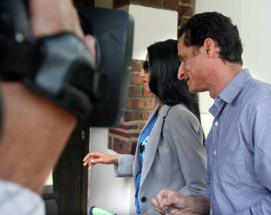 U.S. Rep. Anthony Weiner, D-N.Y., and his wife, Huma Abedin arrive at their home in Queens, N.Y., before he leaves for a press conference on Thursday, June 16, 2011.  Weiner has decided to resign his seat in Congress after a two-week scandal spawned by lewd and even x-rated photos the New York lawmaker took of himself and sent online to numerous women. Photo: Bebeto Matthews, AP / AP