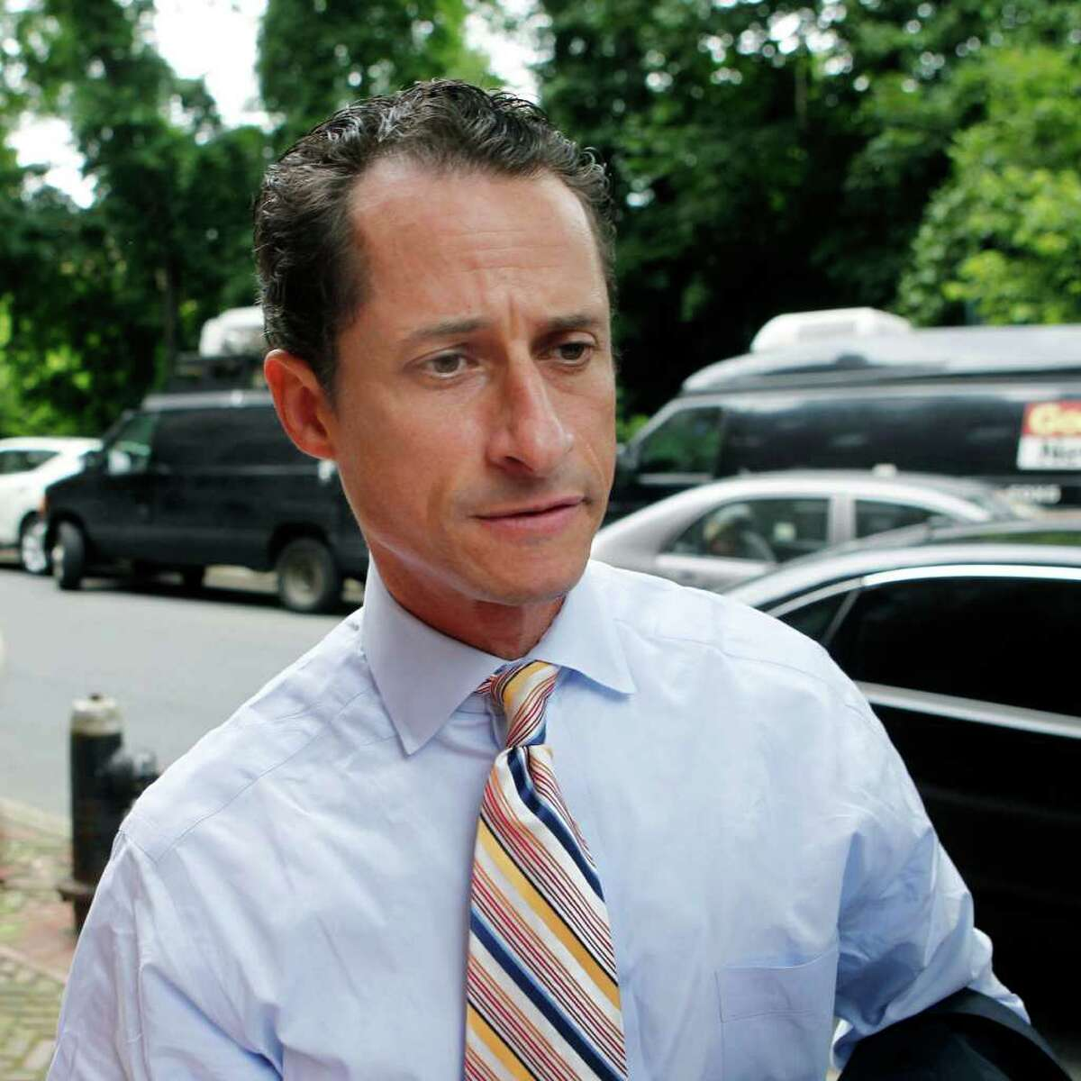 Anthony Weiner returns home after he announced his resignation from Congress Thursday, June 16, 2011 in the Queens borough of New York. Weiner resigned from Congress, saying he cannot continue in office amid the intense controversy surrounding sexually explicit messages he sent online to several women. (