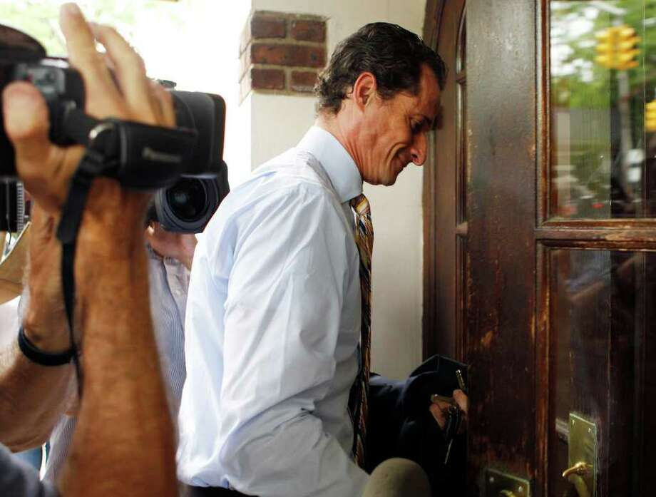 Anthony Weiner returns home after he announced his resignation from Congress Thursday, June 16, 2011  in the Queens borough of New York.  Weiner resigned from Congress, saying he cannot continue in office amid the intense controversy surrounding sexually explicit messages he sent online to several women. Photo: Frank Franklin II, AP / AP