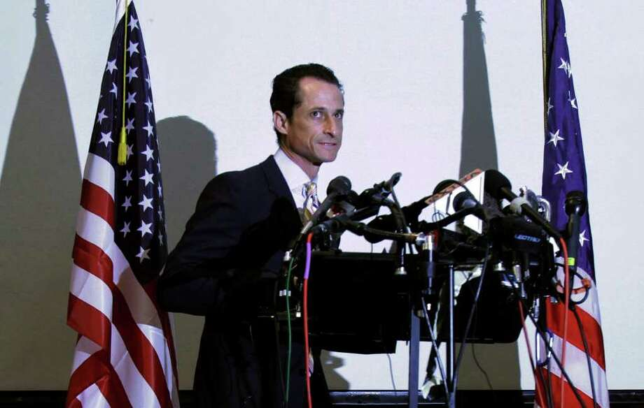 U.S. Rep. Anthony Weiner approaches the podium to announce his resignation from Congress, in the Brooklyn borough of New York,  Thursday, June 16, 2011.  Weiner resigned from Congress, saying he cannot continue in office amid the intense controversy surrounding sexually explicit messages he sent online to several women. Photo: Richard Drew, AP / AP