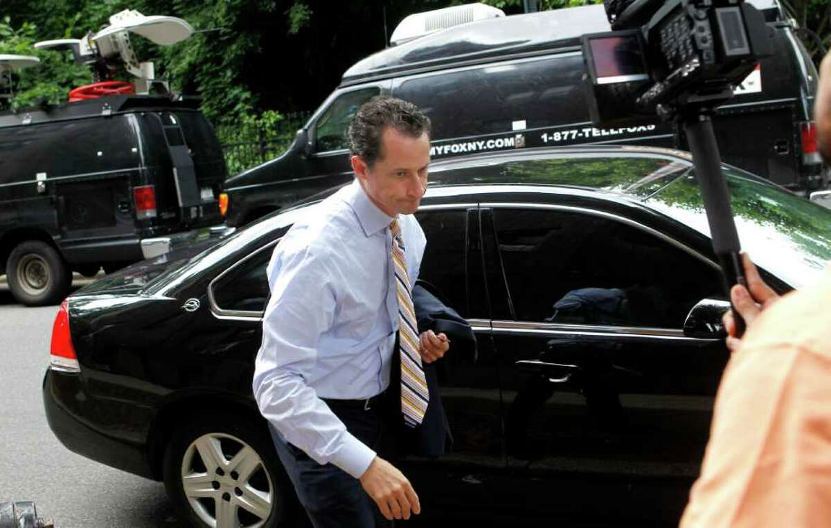 Anthony Weiner returns home after he announced his resignation from Congress Thursday, June 16, 2011 in the Queens borough of New York. Weiner resigned from Congress, saying he cannot continue in office amid the intense controversy surrounding sexually explicit messages he sent online to several women.