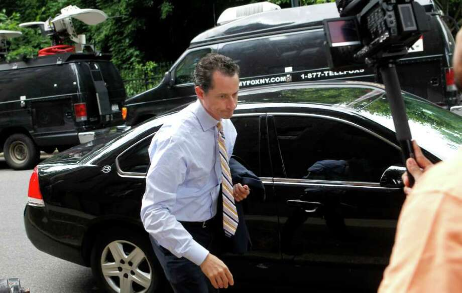Anthony Weiner returns home after he announced his resignation from Congress Thursday, June 16, 2011  in the Queens borough of New York.  Weiner resigned from Congress, saying he cannot continue in office amid the intense controversy surrounding sexually explicit messages he sent online to several women. Photo: Jason DeCrow, AP / FR103966 AP