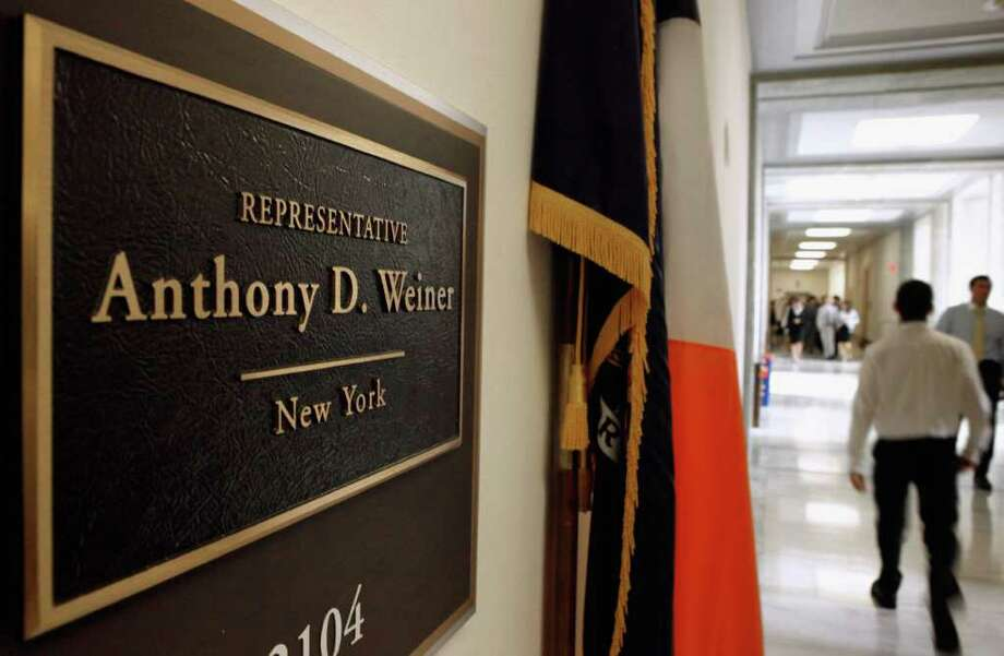 WASHINGTON, DC - JUNE 16:  People walk past the plaque outside Rep. Anthony Weiner's (D-NY) office in the Rayburn House Office Building June 16, 2011 in Washington, DC. According to reports, Weiner has told friends that he intends to resign from the House of Representatives in the wake of a scandal over lewd photographs sent to several women over Twitter. Photo: Chip Somodevilla, Getty Images / 2011 Getty Images