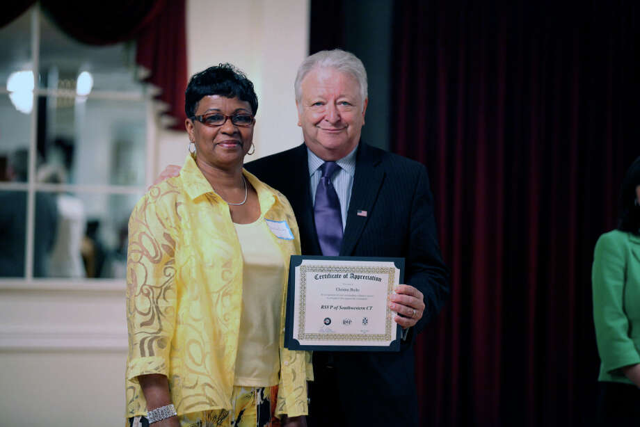 RSVP volunteer Donna Burke receives recognition from Norwalk Mayor Richard Moccia for donating her time to the Norwalk Senior Center, Norwalk Reads and the Norwalk and East Norwalk Libraries. Photo: Contributed Photo / Norwalk Citizen