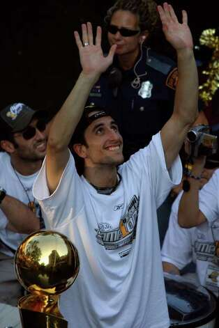 Manu Ginobili rides during Spurs NBA Championship River Parade Saturday, June 25, 2005. Nicole Fruge/San Antonio Express News Photo: NICOLE FRUGE, SAN ANTONIO EXPRESS-NEWS / SAN ANTONIO EXPRESS-NEWS