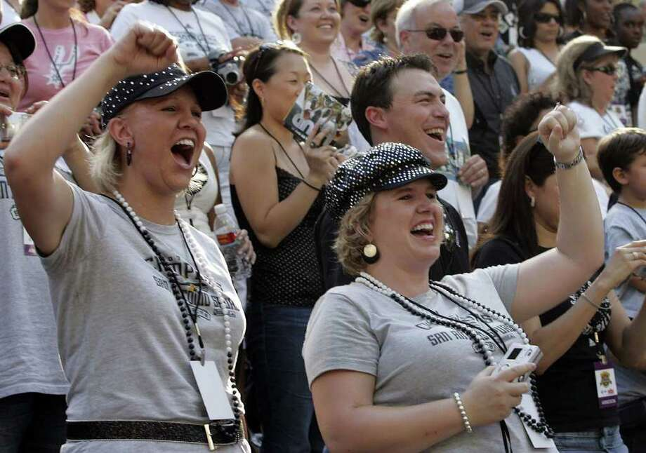 (For 210SA) Jenifer Heirich and Lorrie Falat cheer during the Spurs victory parade in San Antonio, Texas on Sunday, June 17, 2007. (ALICIA WAGNER CALZADA/ SPECIAL TO 210SA) Photo: ALICIA WAGNER CALZADA, SPECIAL TO THE EXPRESS-NEWS / Alicia Wagner Calzada