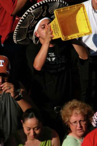 A fan uses a makeshift megaphone during Spurs NBA Championship River Parade Saturday, June 25, 2005. Nicole Fruge/San Antonio Express News Photo: NICOLE FRUGE, SAN ANTONIO EXPRESS-NEWS / SAN ANTONIO EXPRESS-NEWS