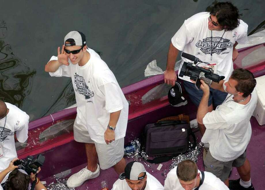 METRO - Manu Ginobili listens to the crowd cheer Wed. June 18, 2003 during the Spurs Parade on the Riverwalk. KEVIN GEIL/STAFF Photo: KEVIN GEIL, EXPRESS-NEWS / EXPRESS-NEWS