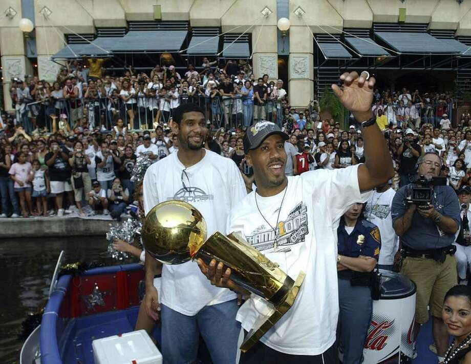 FOR METRO - Spurs' Tim Duncan and Bruce Bowen celebrate during the championship parade through the River Center Lagoon Saturday June 25, 2005. FOR PHOTO BY EDWARD A. ORNELAS Photo: EDWARD A. ORNELAS, SAN ANTONIO EXPRESS-NEWS / SAN ANTONIO EXPRESS-NEWS