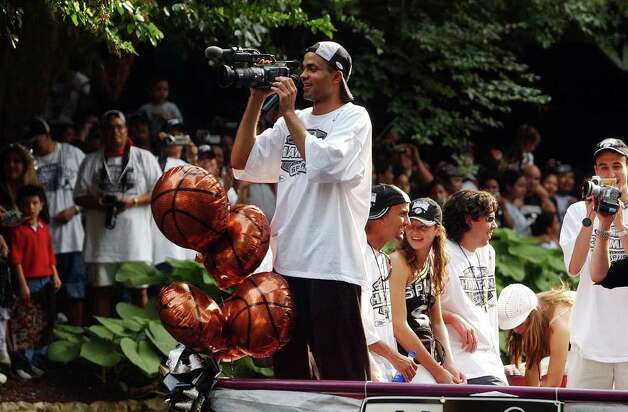 San Antonio Spurs Tony Parker films his way down the Riverwalk during the San Antonio Spurs 2003 NBA Championship river parade  on Wednesday, June 18, 2003. ( JERRY LARA STAFF ) Photo: JERRY LARA, SAN ANTONIO EXPRESS-NEWS / SAN ANTONIO EXPRESS-NEWS