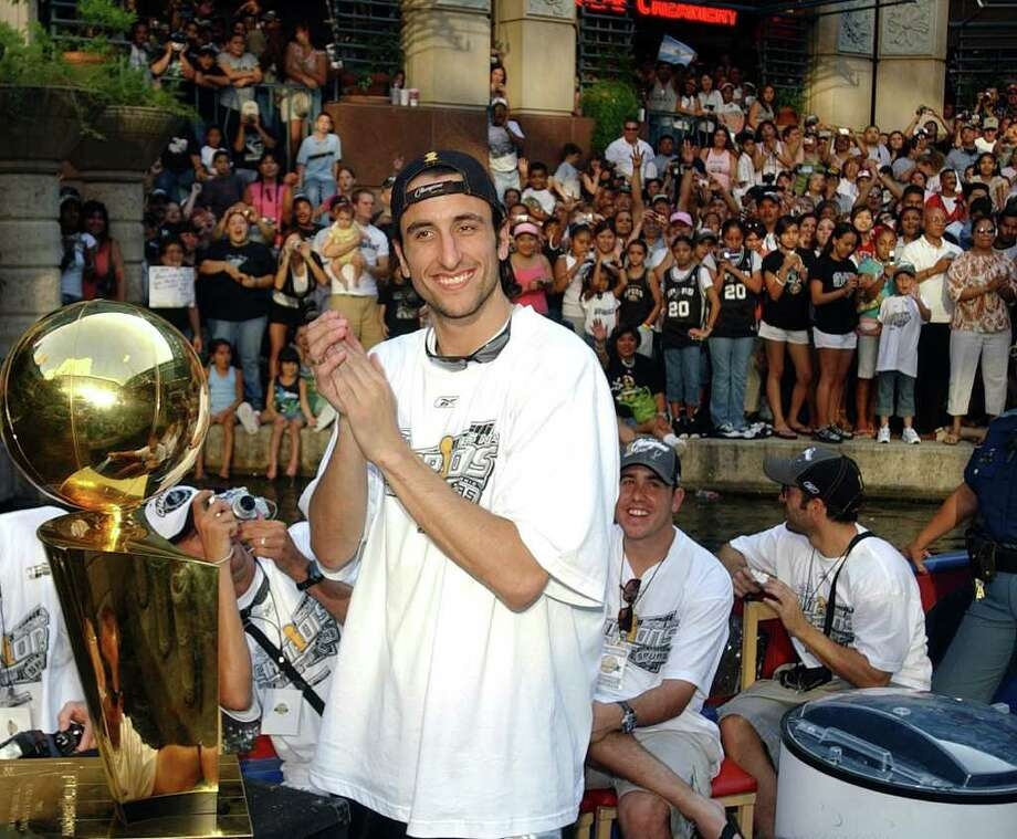 FOR METRO - Spurs' Manu Ginobili is all smiles during the championship parade through the River Center Lagoon Saturday June 25, 2005. FOR PHOTO BY EDWARD A. ORNELAS Photo: EDWARD A. ORNELAS, SAN ANTONIO EXPRESS-NEWS / SAN ANTONIO EXPRESS-NEWS