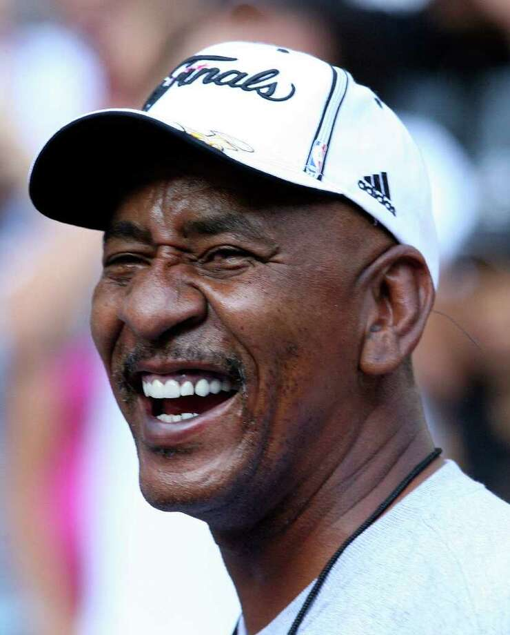 FOR METRO - Former Spurs' player George Gervin is all smiles as he takes part in  the victory parade Sunday June 17, 2007, at the River Center Lagoon (EDWARD A. ORNELAS/STAFF) Photo: EDWARD A. ORNELAS, SAN ANTONIO EXPRESS-NEWS / SAN ANTONIO EXPRESS-NEWS