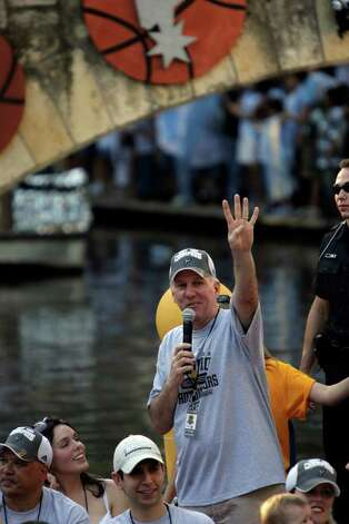 San Antonio Spurs Head Coach Gregg Popovich celebrates his fourth NBA Championship title during a parade down the Riverwalk on Sunday, June, 17, 2007.  ( JERRY LARA STAFF ) Photo: JERRY LARA, SAN ANTONIO EXPRESS-NEWS / SAN ANTONIO EXPRESS-NEWS
