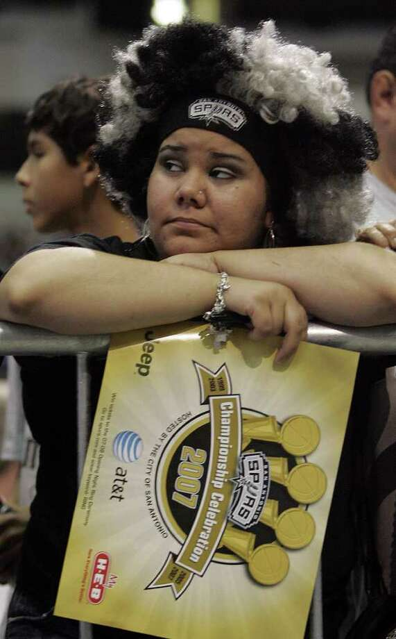 (For 210SA) Francheska Morales takes a rest before the Spurs victory celebration at the Alamodome in San Antonio, Texas on Sunday, June 17, 2007. (ALICIA WAGNER CALZADA/ SPECIAL TO 210SA) Photo: ALICIA WAGNER CALZADA, SPECIAL TO THE EXPRESS-NEWS / Alicia Wagner Calzada