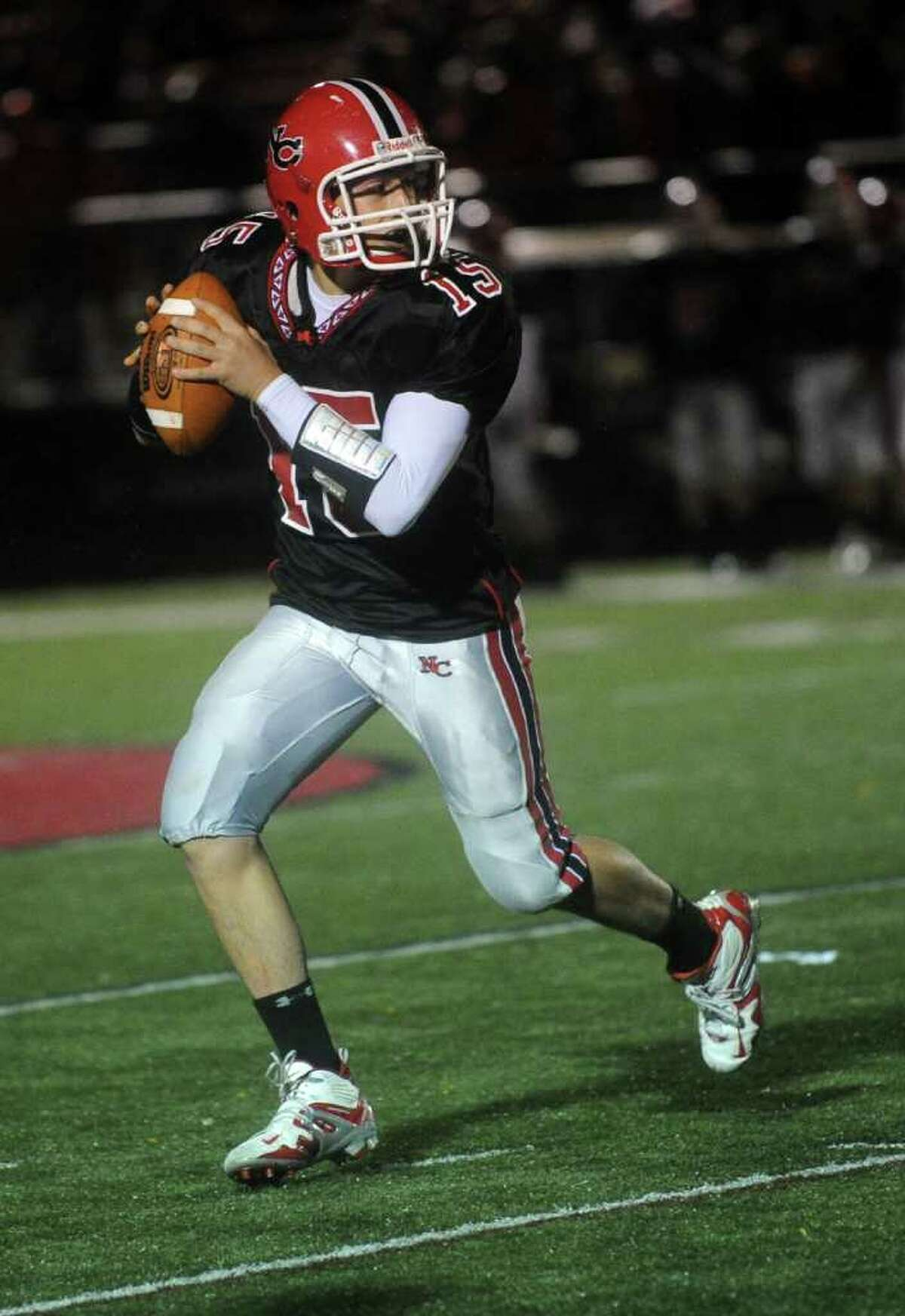 New Canaan quarterback Matt MIlano during Friday's game against Seymour at New Canaan High School on October 15, 2010.