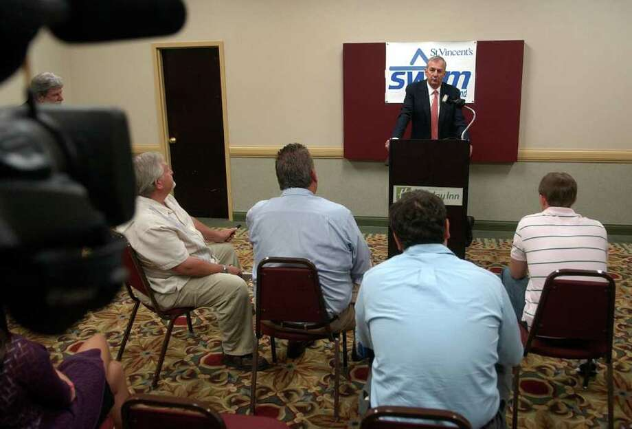 UConn Coach Jim Calhoun answers questions from the media during a press conference before St. Vincent's Swim Across the Sound 8th Annual Prostate Cancer Institue Celebrity Dinner which was held at the Holiday Inn in downtown Bridgeport, Conn. on Thursday June 16, 2011. Photo: Christian Abraham / Connecticut Post