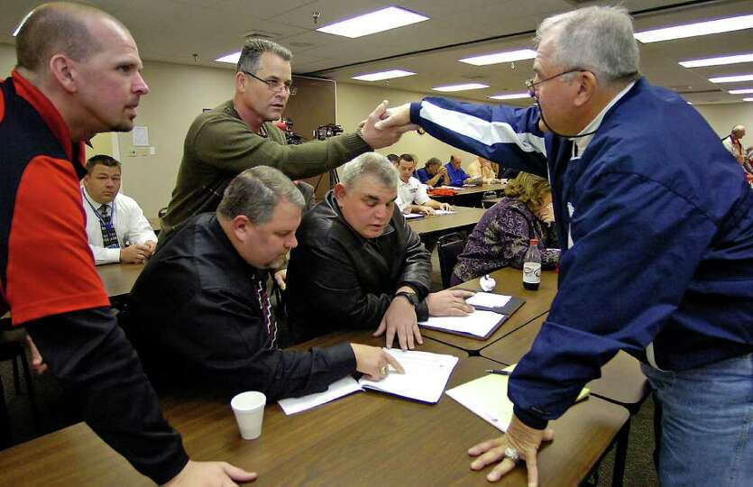 Richard Hazlewood, Superintendent of Kirbyville CISD, second from left, shakes hands with West Orang