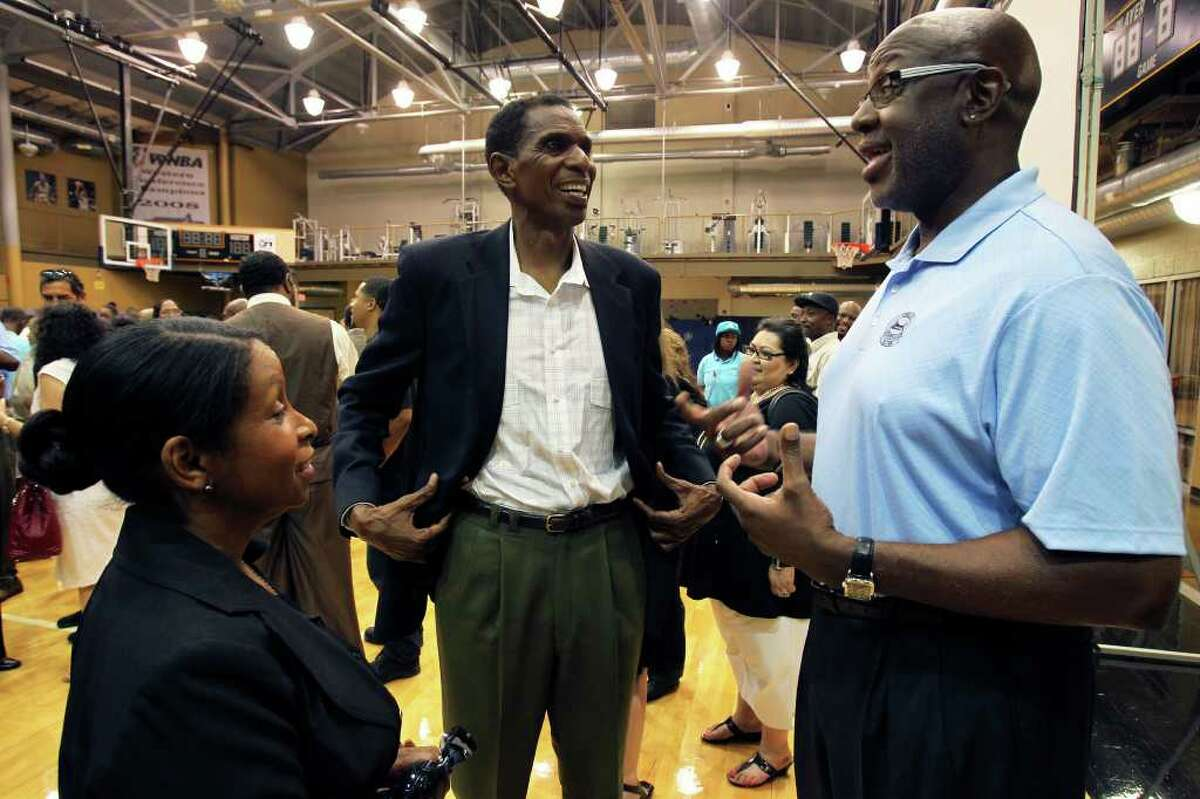 Campy Russell (right) chats with Larry and Vanessa Kenon after the memorial service for Spurs great Mike Mitchell at the Antioch Sports Center on June 16, 2011. Tom Reel/Staff