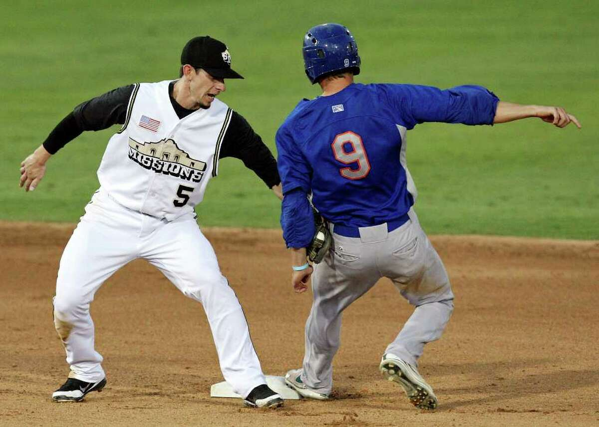 Missions' Anthony Contreras tags out Rockhounds' Grant Green as he tries to steal second during the sixth inning.
