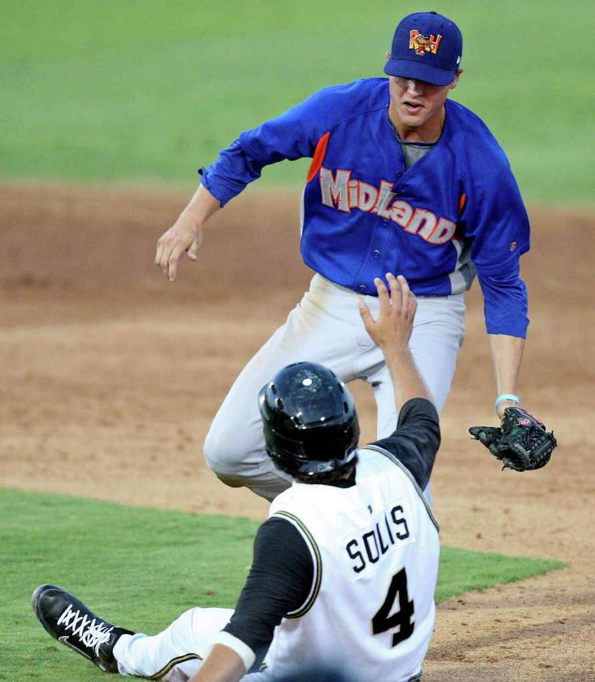 Missions' Ali Solis is tagged out by Rockhounds' Grant Green after slipping during a rundown in the fifth inning.