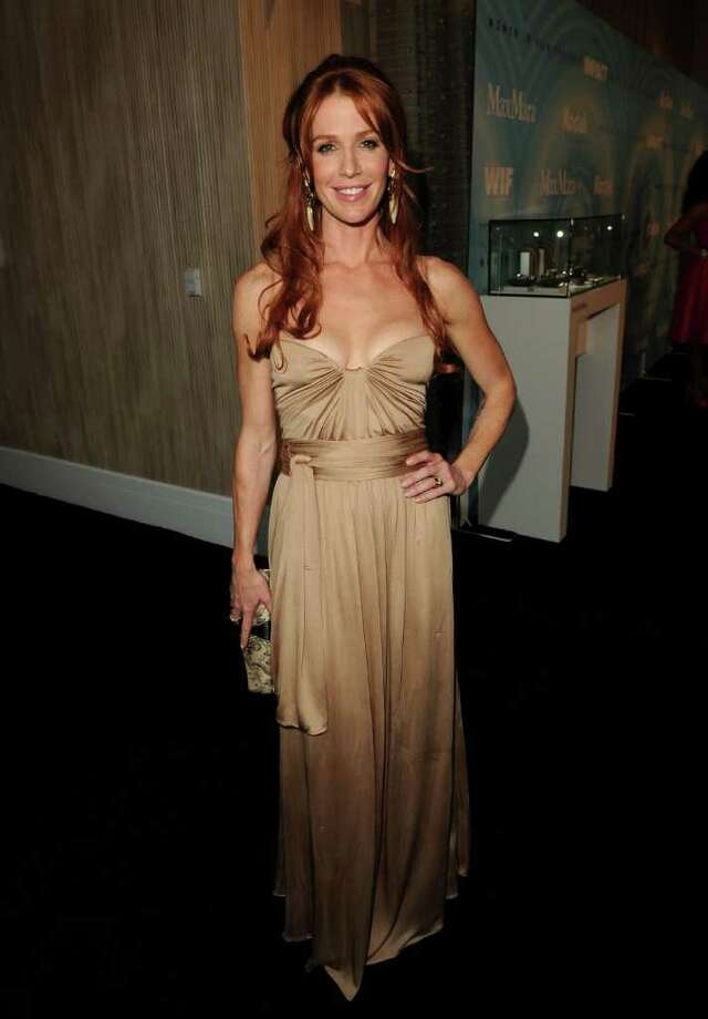 Actress Poppy Montgomery arrives. Photo: Jason Merritt, Getty Images For WIF / 2011 Getty Images
