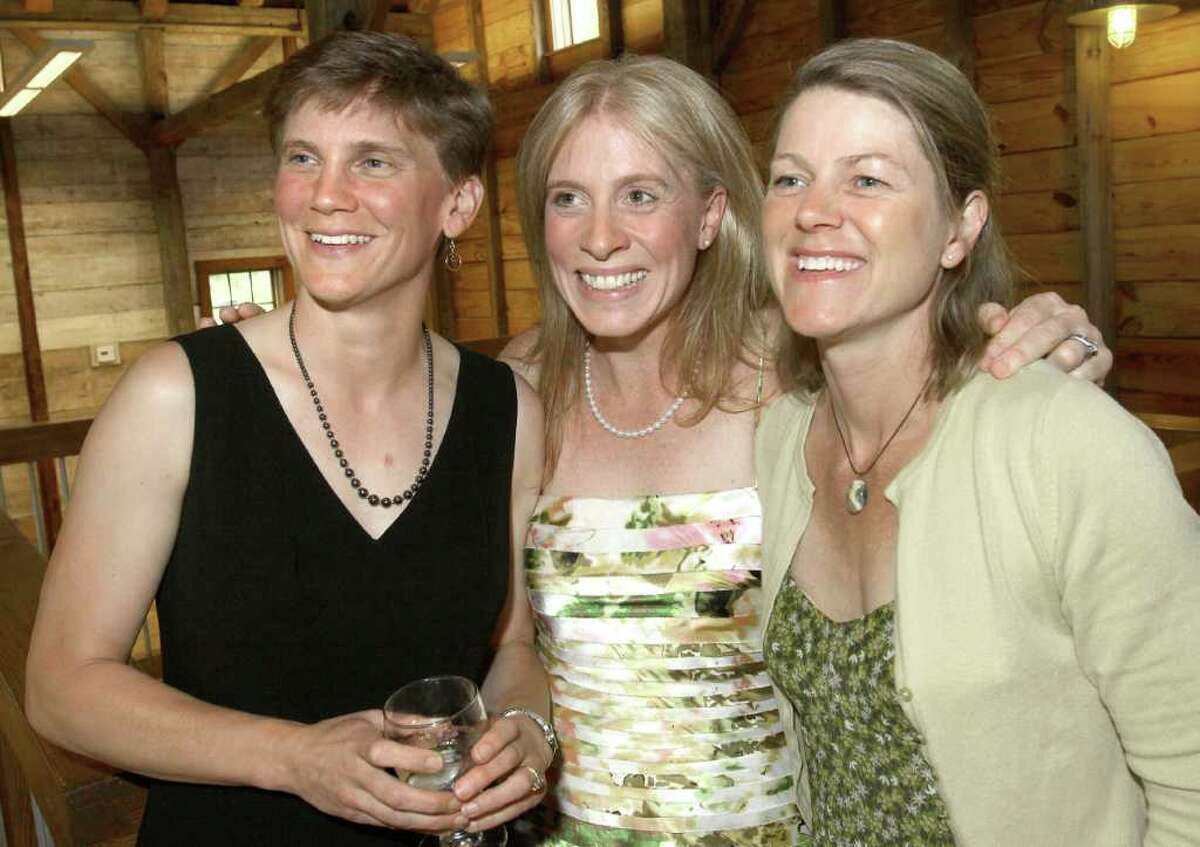 Event honoree Linda Schadler, Ph.D., left, poses with firends Kelly Anderson , center, and Michelle Rosowsky so her daughter could take a photo during the Children's Museum of Science and Technology's Spring Gala June 9, 2011, in Troy. (Joe Putrock / Special to the Times Union)
