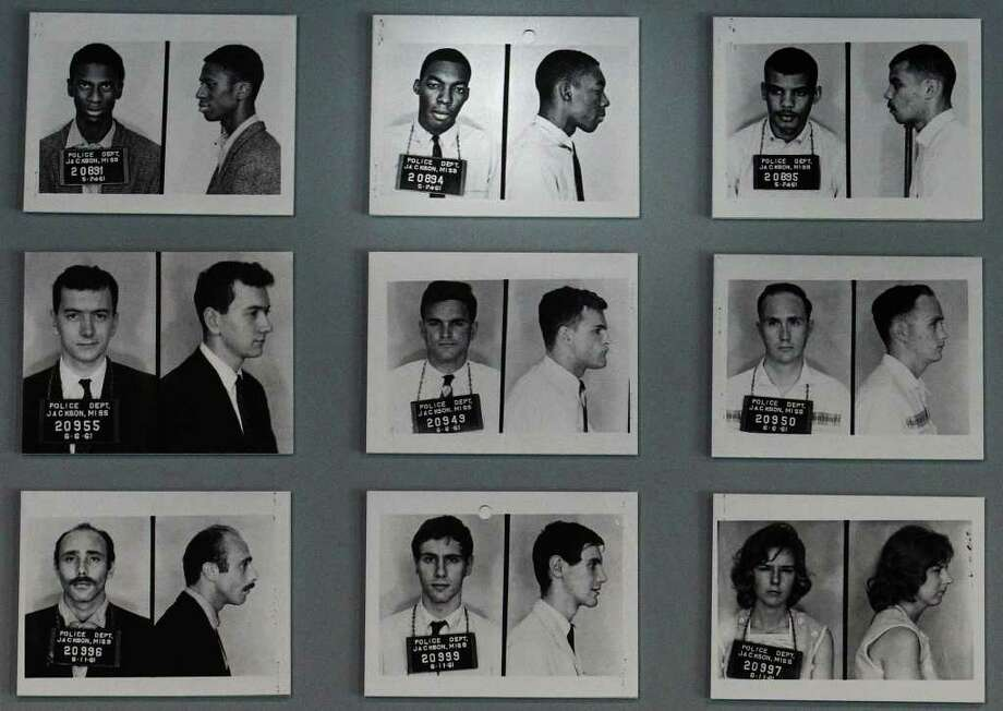 Freedom Riders 50th reunion in Jackson, Miss., on May 26, 2011. The image of Hank Thomas' police booking photo (top center) is shown with fellow Freedom Riders on display at the Mississippi Museum of Art in Jackson. Photo: KIN MAN HUI, Kin Man Hui/kmhui@express-news.net / San Antonio Express-News