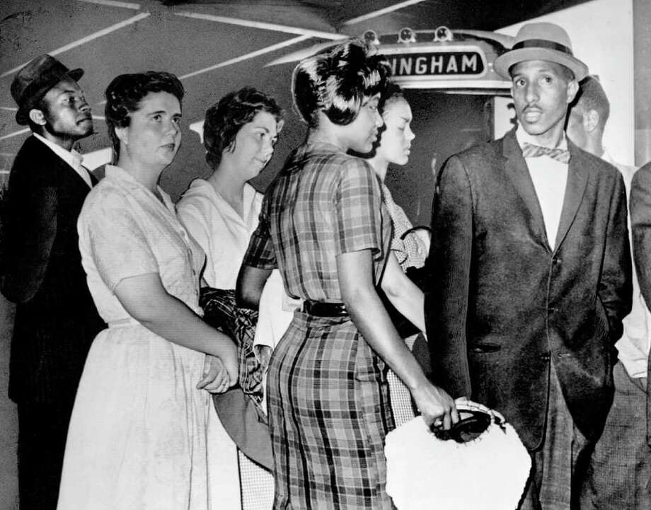 A group of Freedom Riders from Tennessee stands at the door of a Greyhound bus in Birmingham,Ala.,  waiting for a bus to leave for Montgomery on May 19, 1961. The Tennessee Board of Regents has changed its decision to deny honorary degrees to 14  students, at what is now called Tennessee State University, who were expelled for participating in Freedom Rides of the 1960s civil rights movement. The board voted unanimously on Friday, April 25, 2008, to change its March vote, which brought criticism from civil rights activists. Photo: Anonymous, AP / AP2008