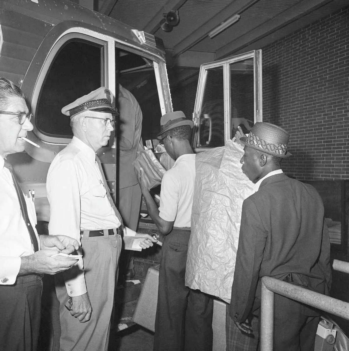 Four of the nine reverse Freedom Riders board bus in New Orleans, en route for Boston and Concord, N.H. with one-way tickets paid for by the New Orleans Citizens Council, July 6, 1962. They are due to arrive in Boston on Sunday at 1:30 p.m. Bus driver is O.E. Coleman of Columbus, Ga.