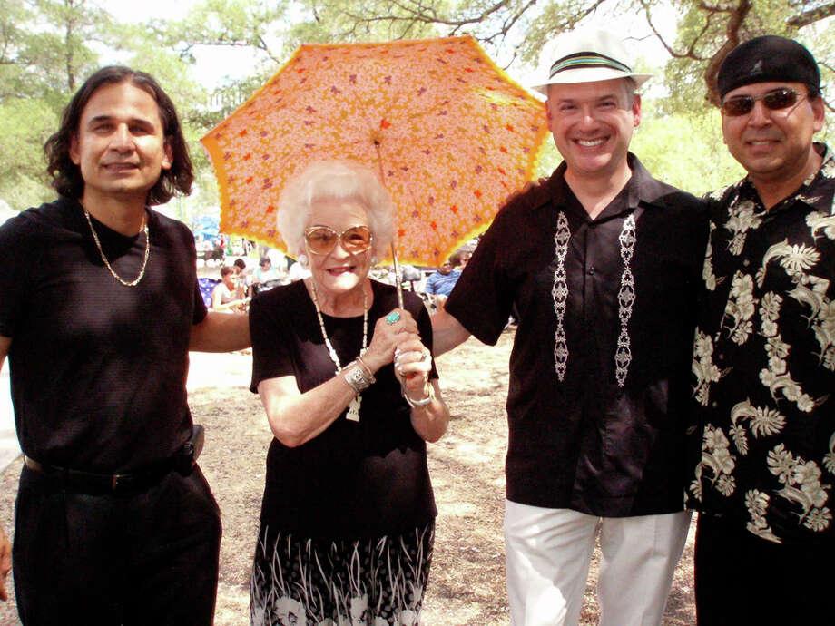 Jesse Garza (from left), Bette Cook, Ken Slavin and Antonio Garza enjoy a hot afternoon at the Art & Jazz Festival in Crockett Park. NANCY COOK-MONROE