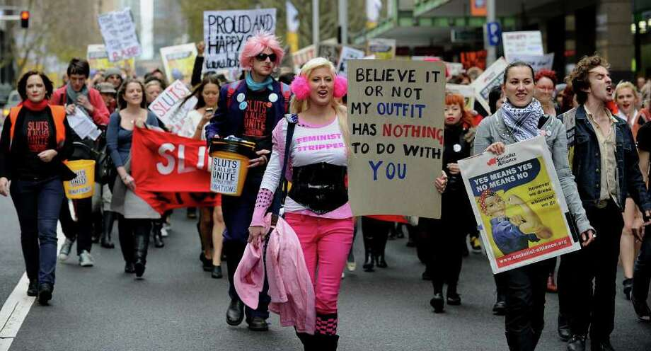 "Participants march for ""SlutWalk"" in Sydney on June 13, 2011, protesting for women to be able to wear whatever they like without fear of being sexually assaulted. SlutWalk began in Canada in April after a Toronto police official said that ""women should avoid dressing like sluts in order not to be victimised"". AFP PHOTO / Greg WOOD Photo: GREG WOOD, AFP/Getty Images / 2011 AFP"