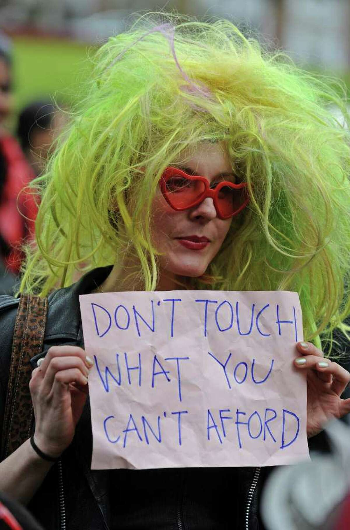 A participant holds a sign during a rally following a march for
