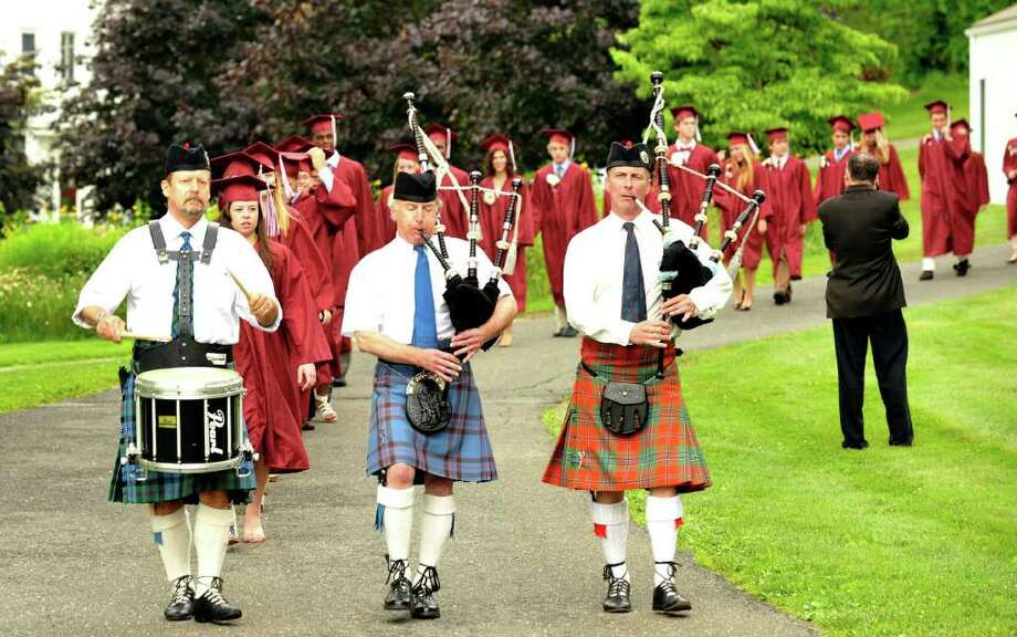 Graduates are led by pipe and drum musicans during the processional starting Wooster School graduation in Danbury, Friday, June 17, 2011. Photo: Michael Duffy / The News-Times