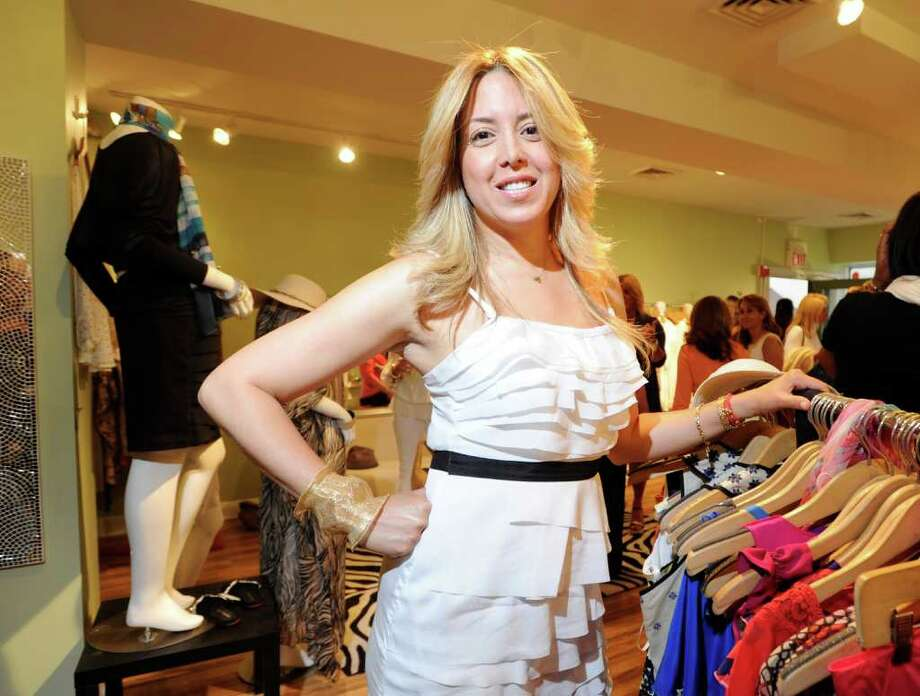 Crave Boutique owner, Sonia Hedvat, in her Greenwich store located at 39 Lewis Street, Greenwich, Thursday night June 16, 2011. Photo: Bob Luckey / Greenwich Time