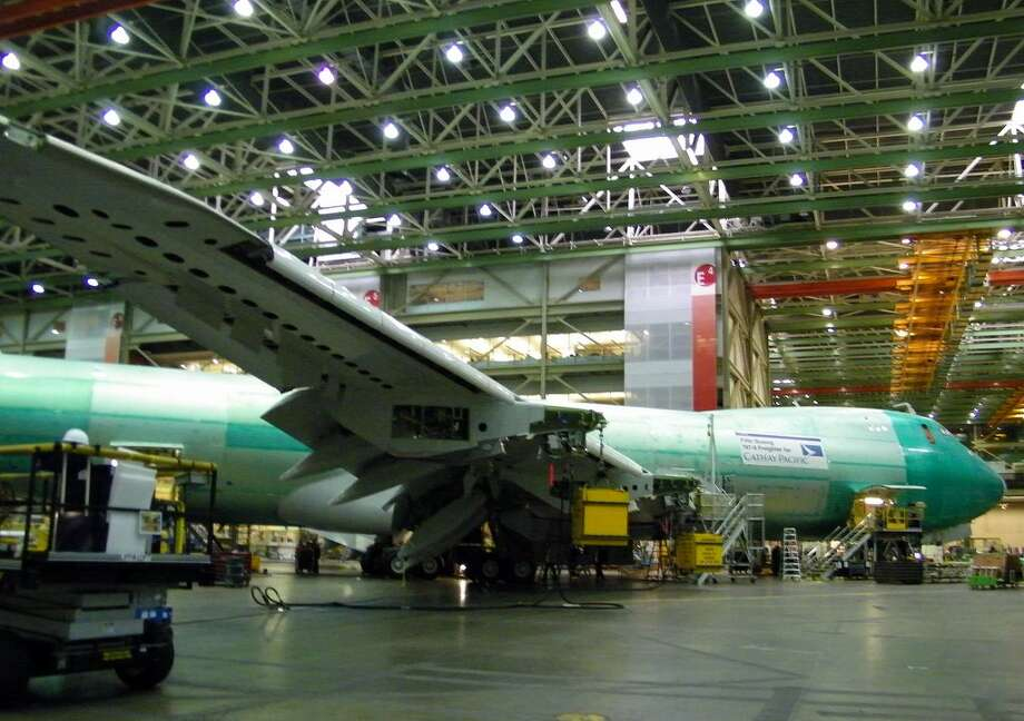A Boeing 747-8 Freighter for Cathay Pacific is seen in assembly on Thursday, June 2, 2011 in Boeing's wide-body plant in Everett, Wash. Photo: Picasa, Aubrey Cohen/seattlepi.com